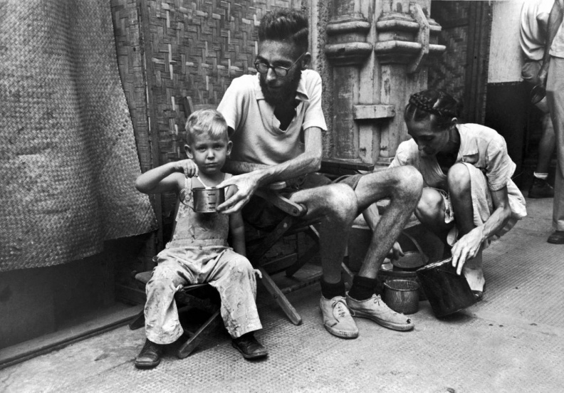 1945 Santo Tomas Father-feeding-boy.jpg